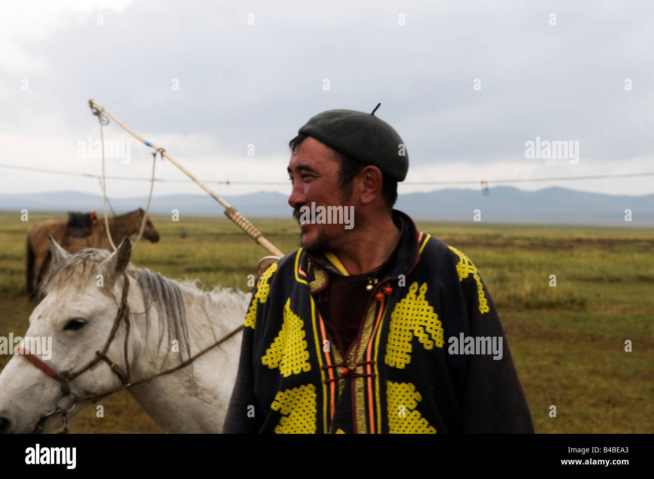 a-mongolian-herder-with-his-horse-in-the