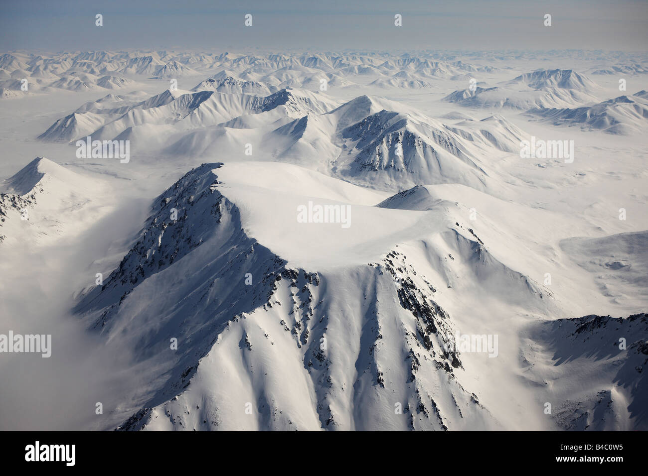 Aerial of snow covered mountains, between Egvekinot and Anadyr  Chukotka Siberia, Russia - Stock Image