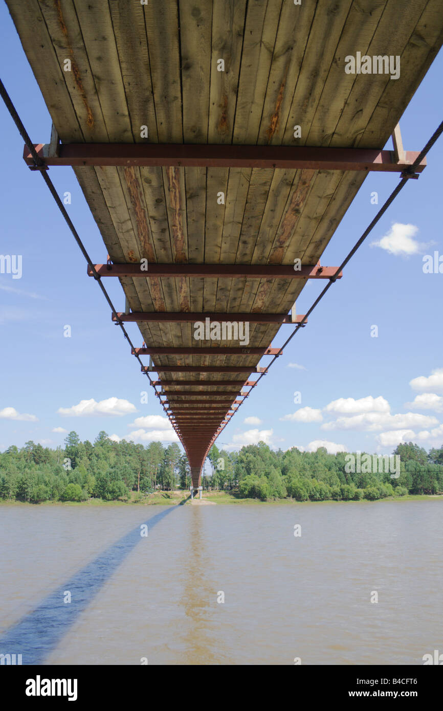 pendant footbridge over river Irkut - Stock Image