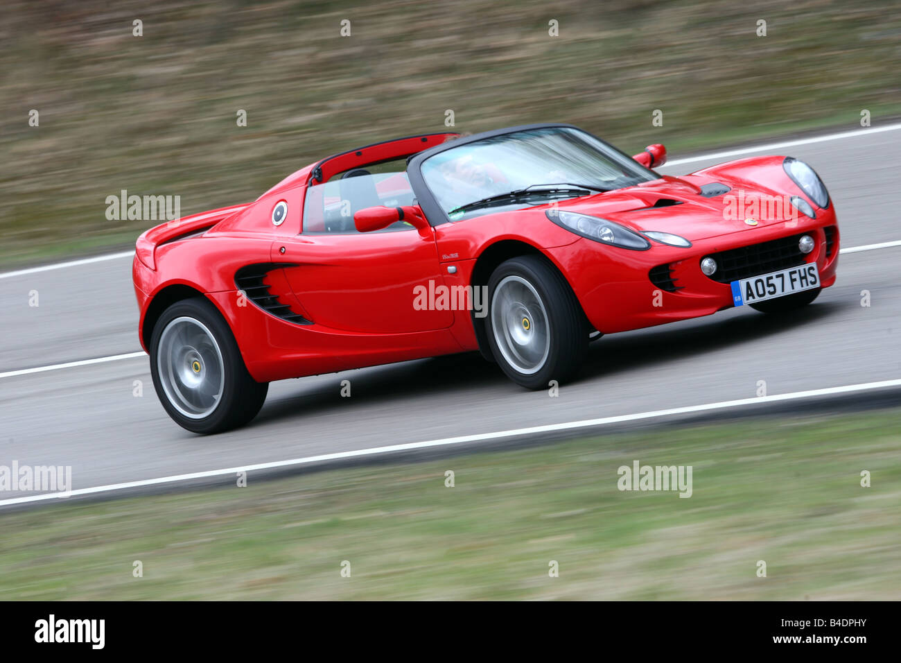 Lotus Elise SC, model year 2008-, red, driving, diagonal from the ...
