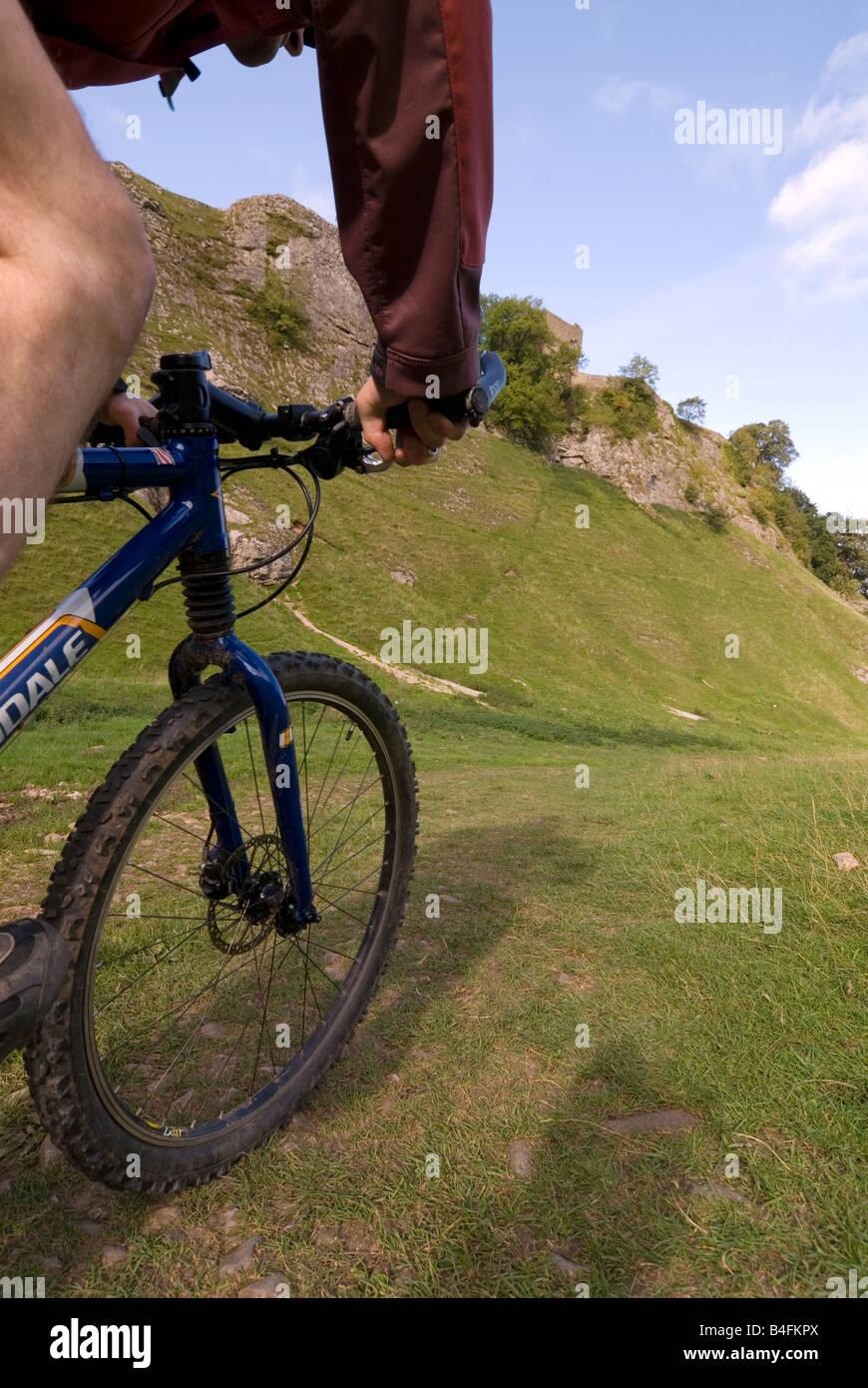 Mountain biking through Cavedale Castleton Peak District National Park Derbyshire England UK GB - Stock Image