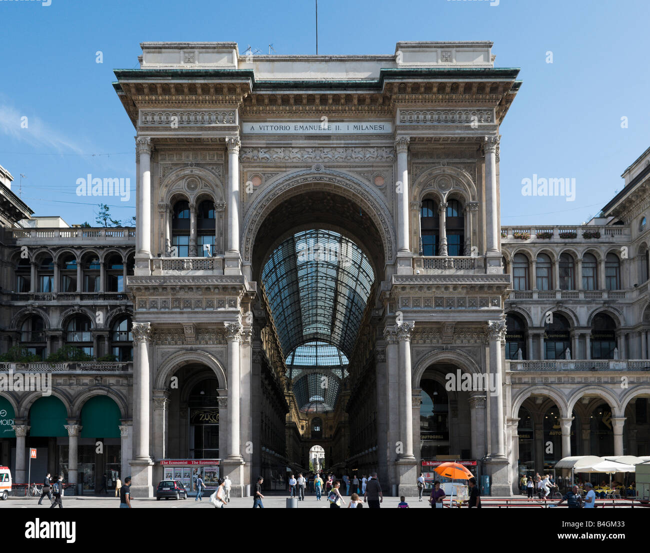 Entrance to Galleria Vittorio Emmanuele II designed by Guiseppe Mengoni, Piazza del Duomo, Milan, Lombardy, Italy - Stock Image