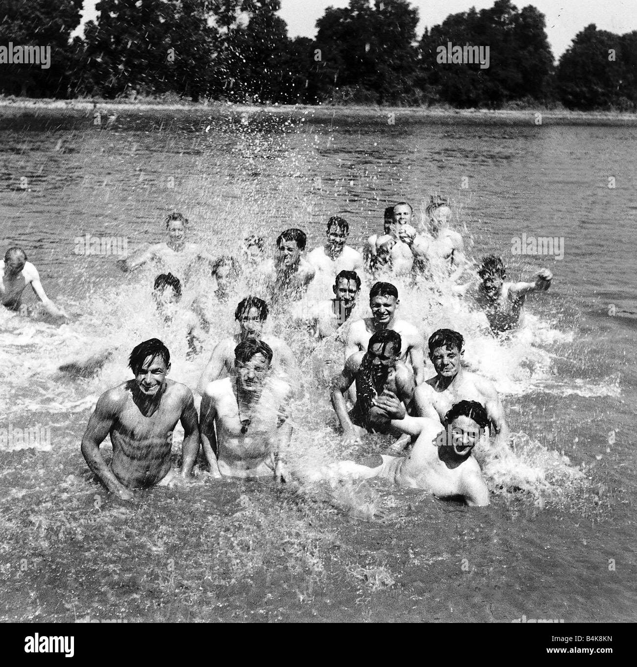 Paratroops from the US 6th Airborne Division enjoy a swim in a canal near the battlefront during WW2 1944 - Stock Image