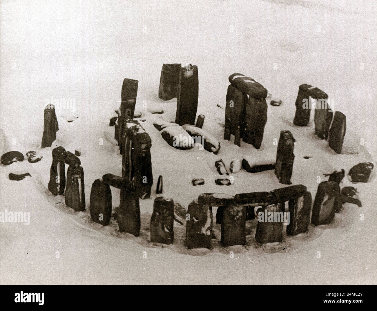 An aerial view of the ruins of Stonehenge in Wiltshire covered in snow January 1963 Stock Photo