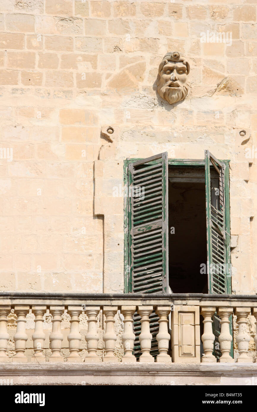 Old shuttered doors lending to balcony with creepy stone face. - Stock Image & Shuttered Doors Stock Photos \u0026 Shuttered Doors Stock Images - Alamy