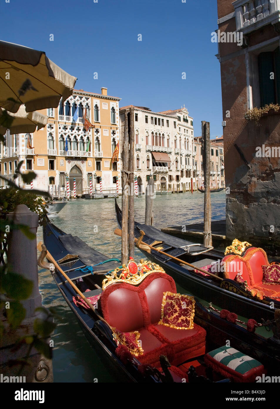 Gondolas moored on the Grand Canal in Venice - Stock Image
