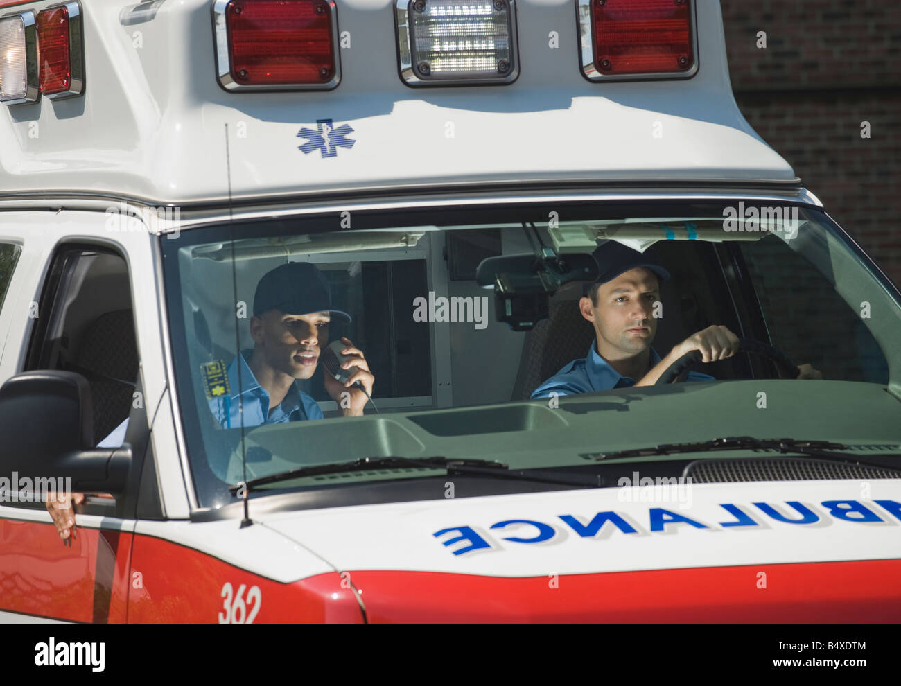 EMT's driving in ambulance - Stock Image