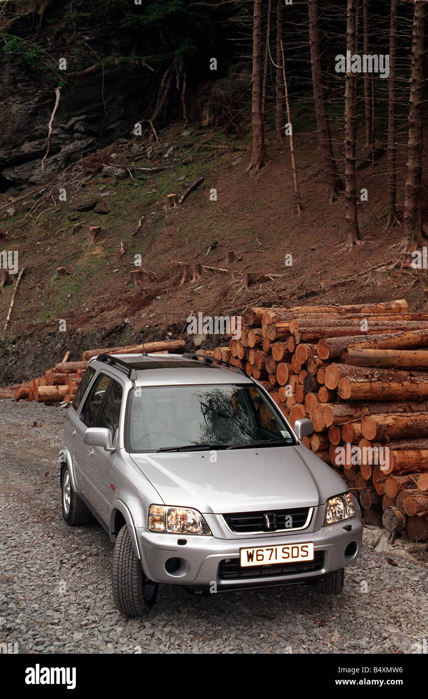The Honda CRV 4x4 pictured in pine woods Scotland - Stock Image