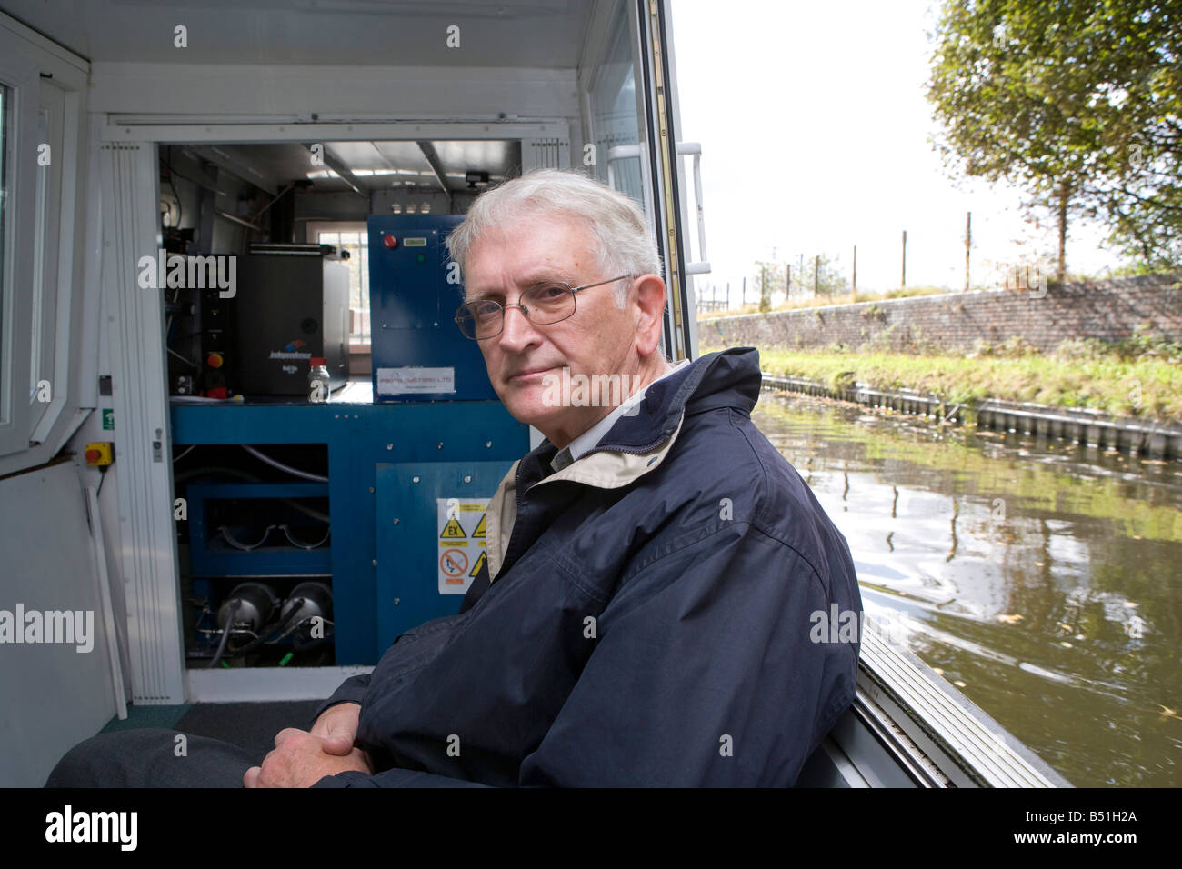 rofessor Rex Harris who developed the boat is  in front of the fuel cells and hydride cylinders - Stock Image