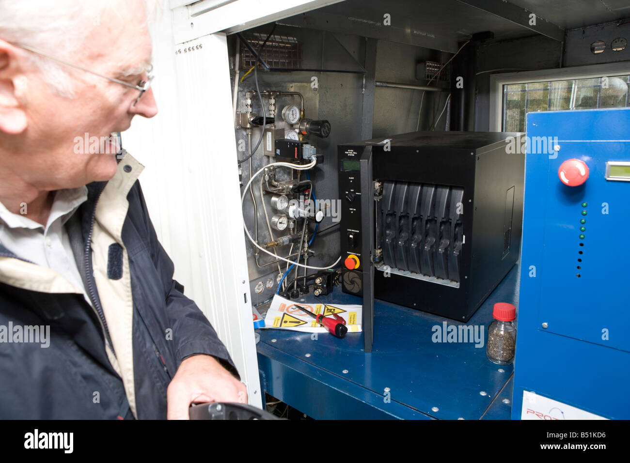 Professor Rex Harris who developed the boat is infront of the fuel cells - Stock Image