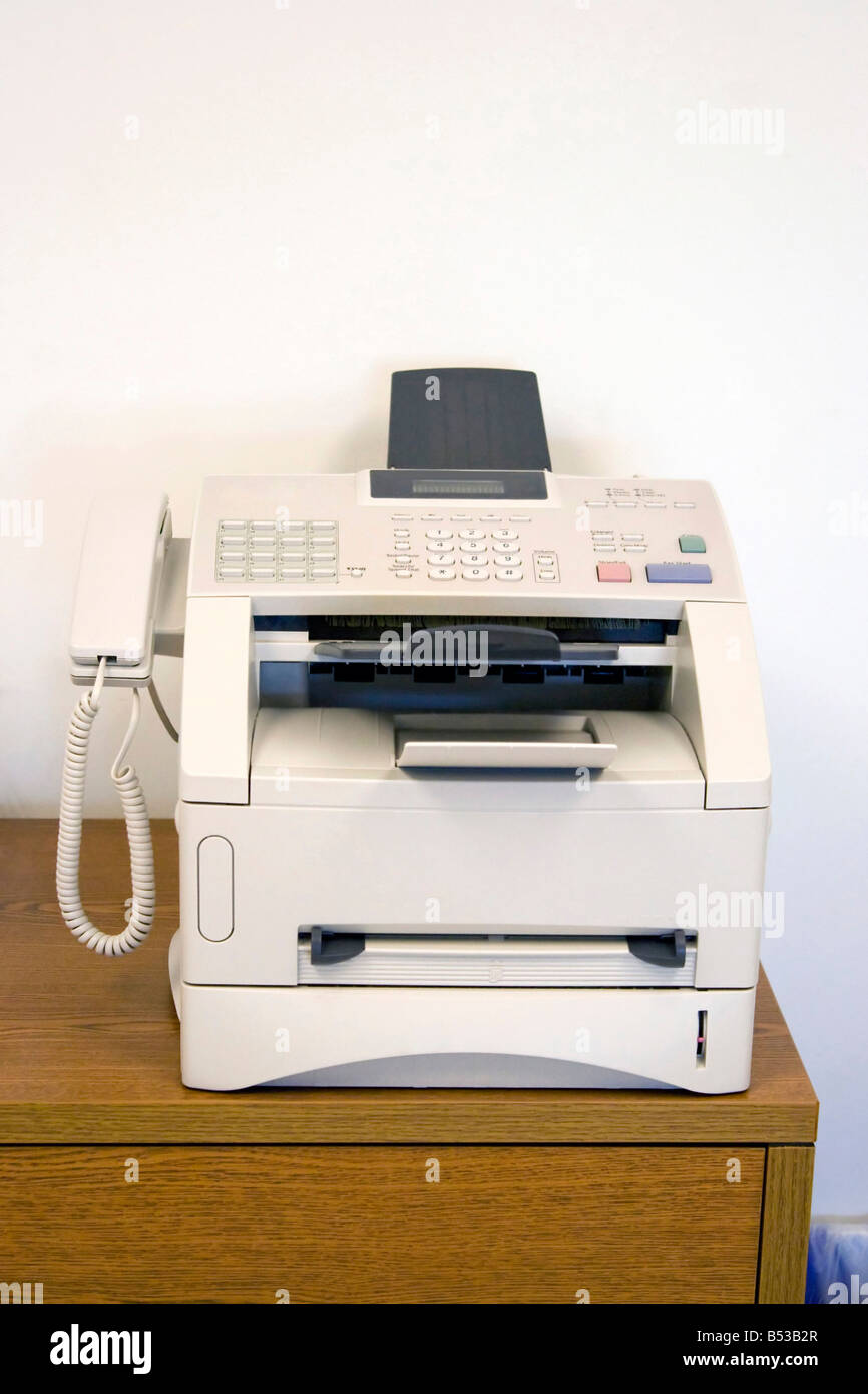 a fax machine sitting on a table in the office a must have tool for