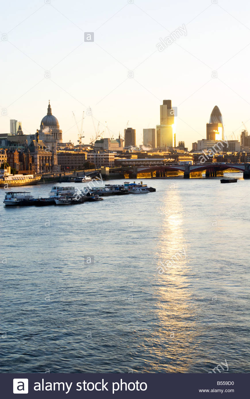The River Thames and the city skyline at sunrise, London, UK. - Stock Image