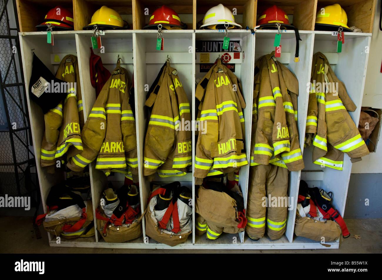 Protective firemen uniforms - Stock Image