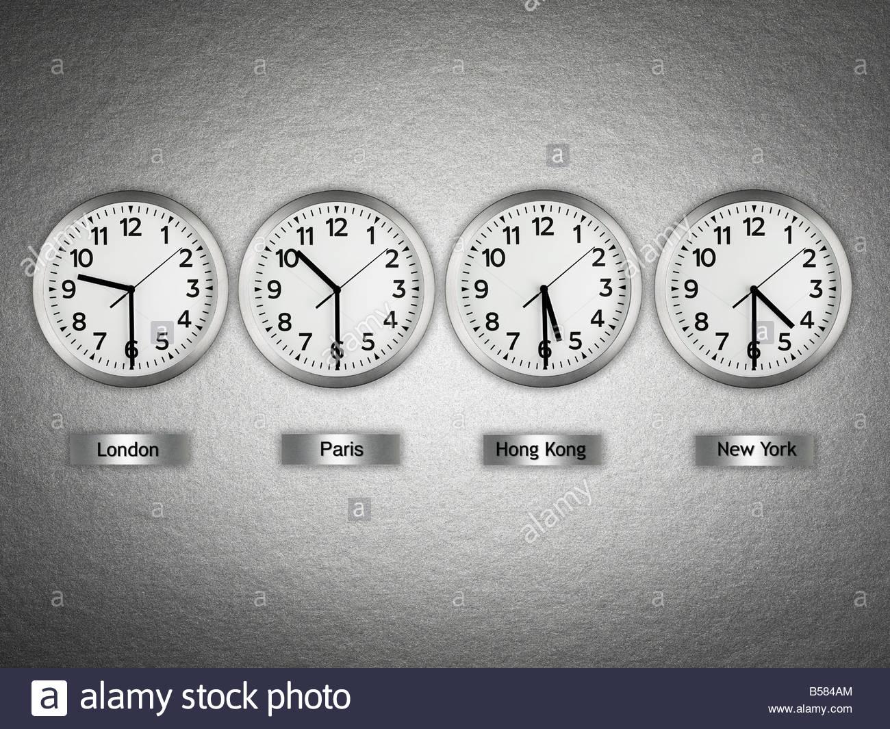 International wall clocks - Stock Image
