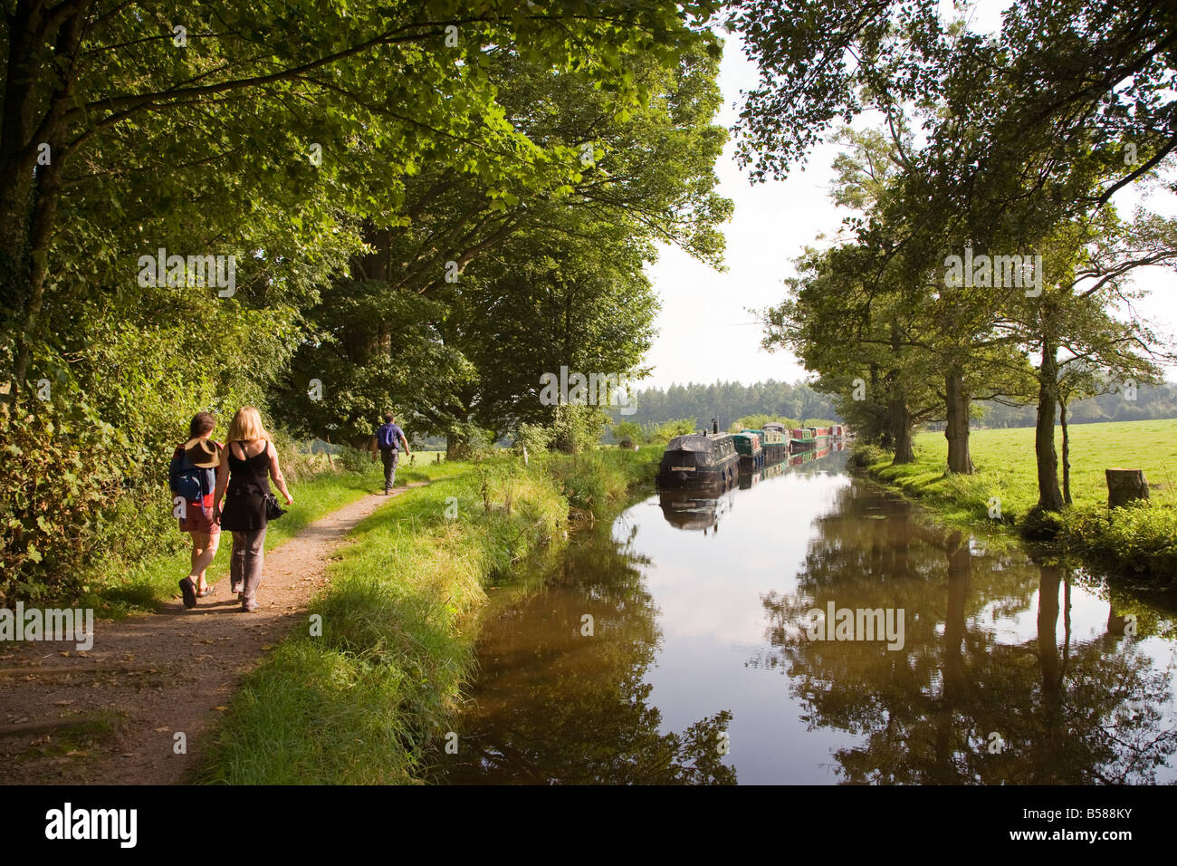 People walking on canal towpath Brecon and Monmouthshire canal Wales UK Stock Photo