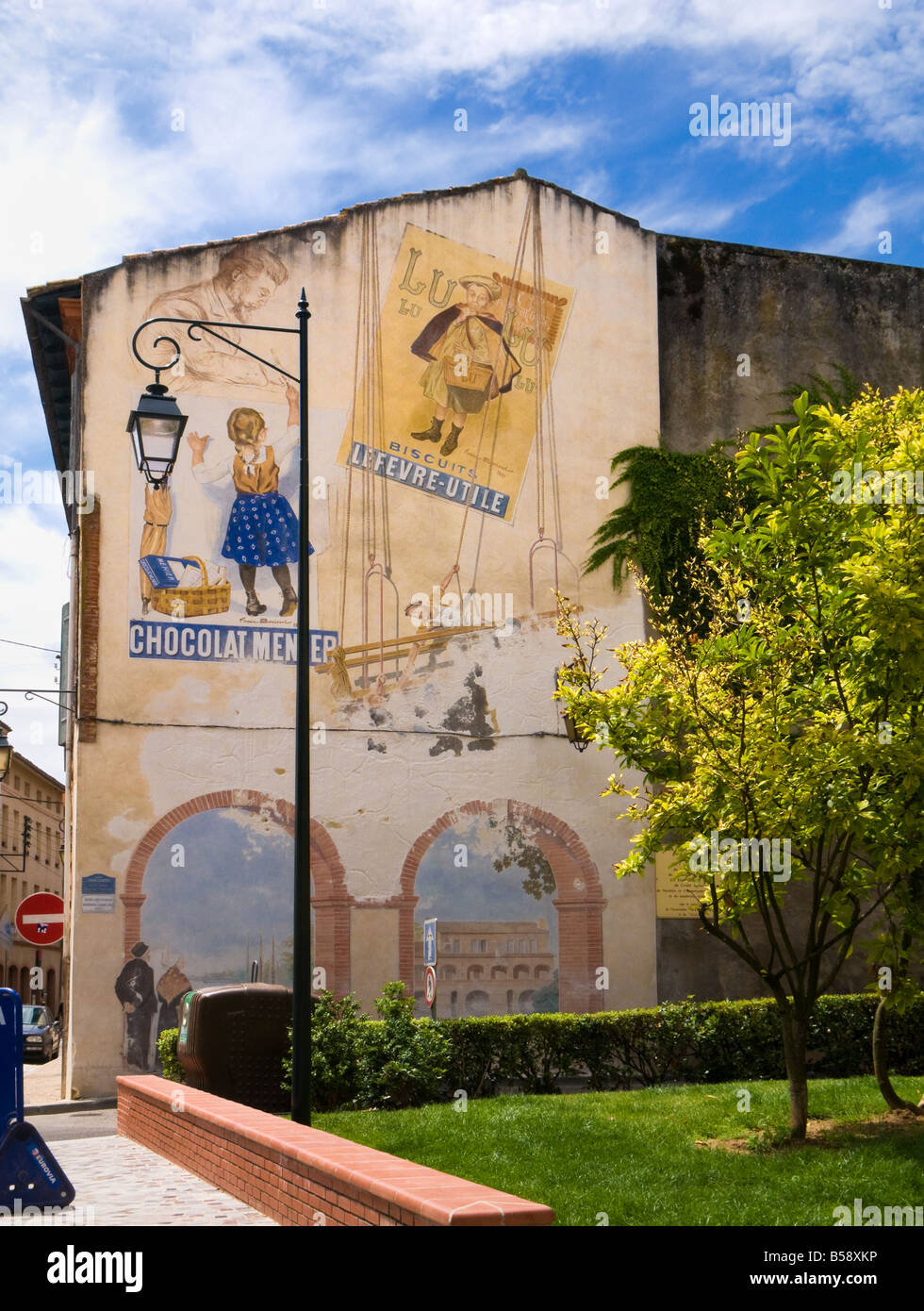 Vintage French advertising posters painted as a street art mural in Moissac Tarn et Garonne France Europe - Stock Image