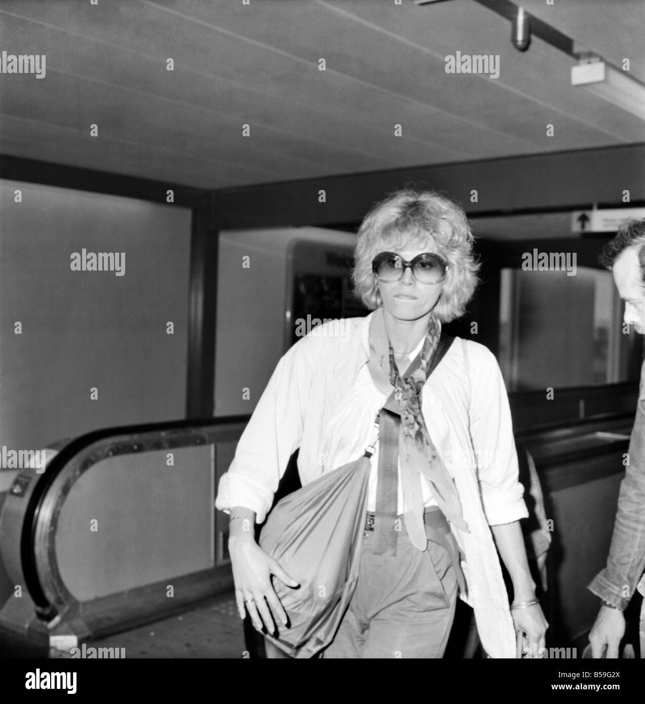 Joanna Lumley with her son and a friend seen leaving Heathrow Airport today for Canada. August 1977 77-04381 - Stock Image