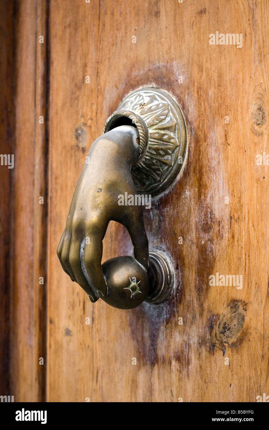Bon Old Brass Door Knocker Of Hand Holding An Orange In Calle Caballeros In The  Historical El Carmen City Centre Of Valencia Spain