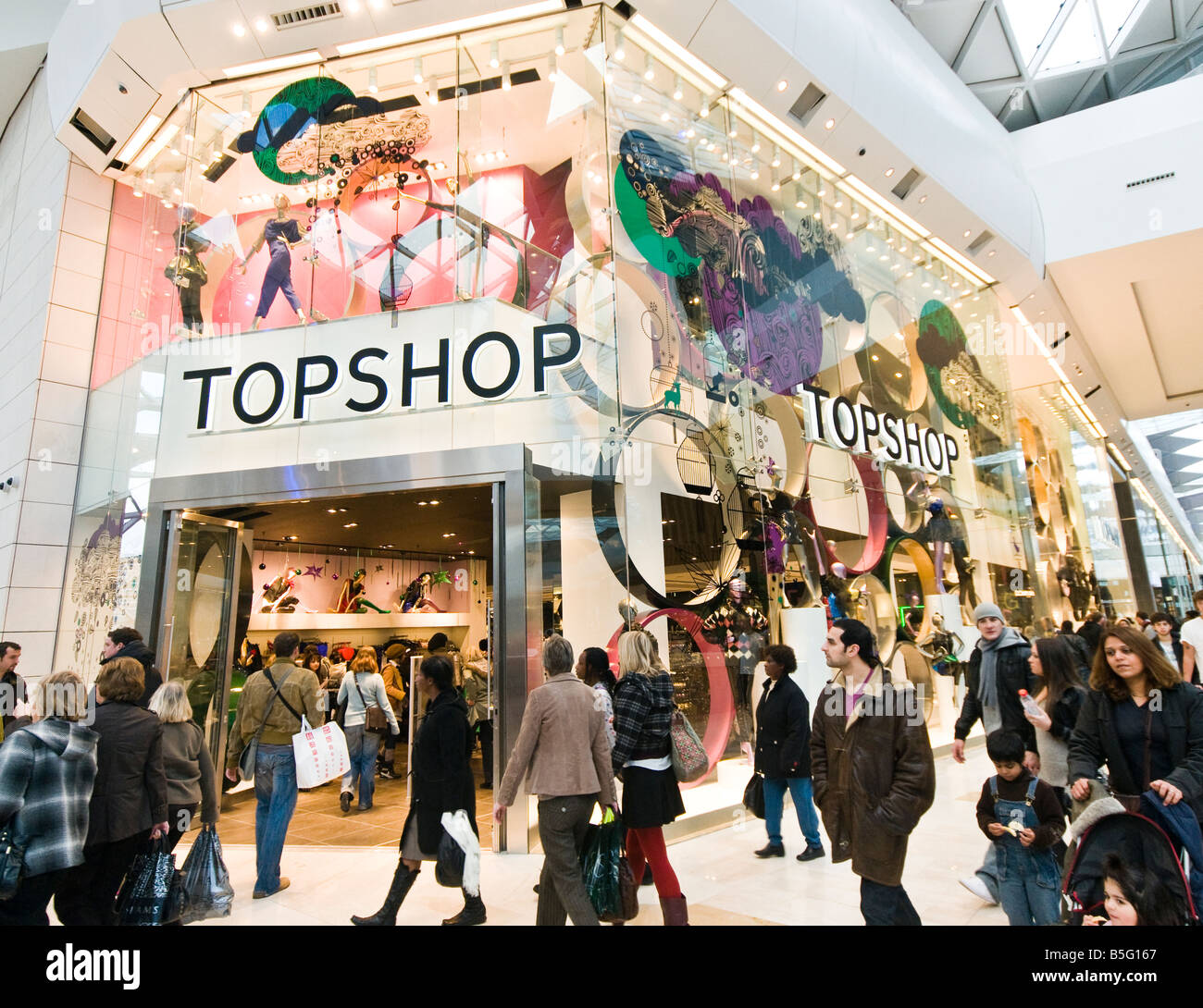 Shoppers ouside Topshop in Westfield shopping mall London Stock Photo