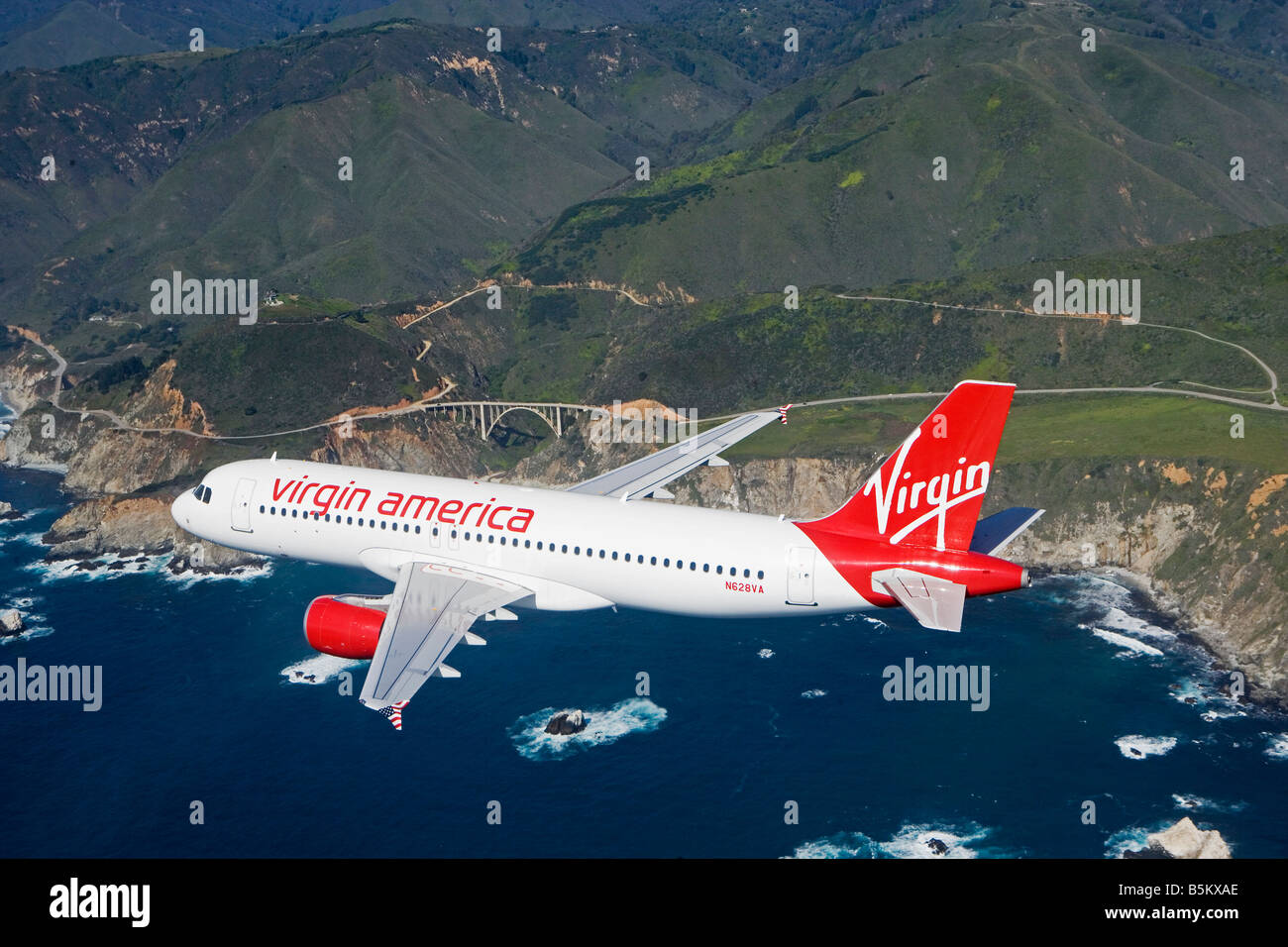 aerial air to air Virgin America air lines Airbus A320 over Pacific coast northern California - Stock Image