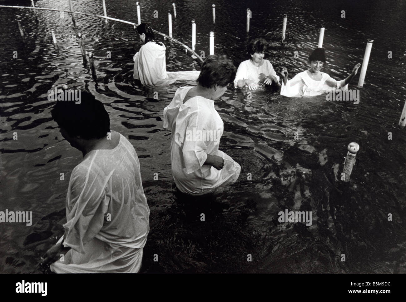 Pilgrims being baptised in the River Jordan, Kibbutz Kinneret, Israel 1999 - Stock Image