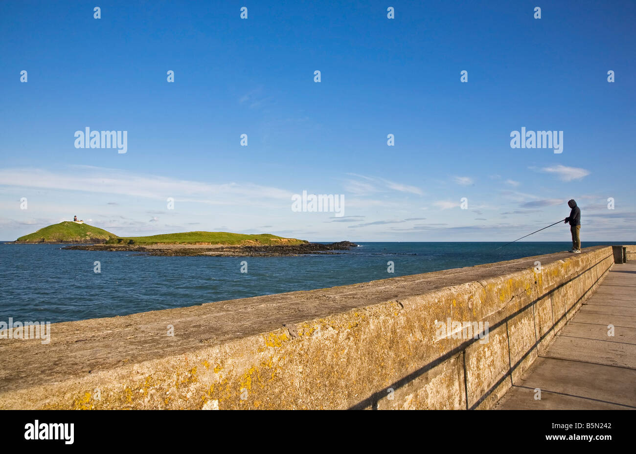 Sea Angling from Ballycotton Harbour Wall, County Cork, Ireland - Stock Image