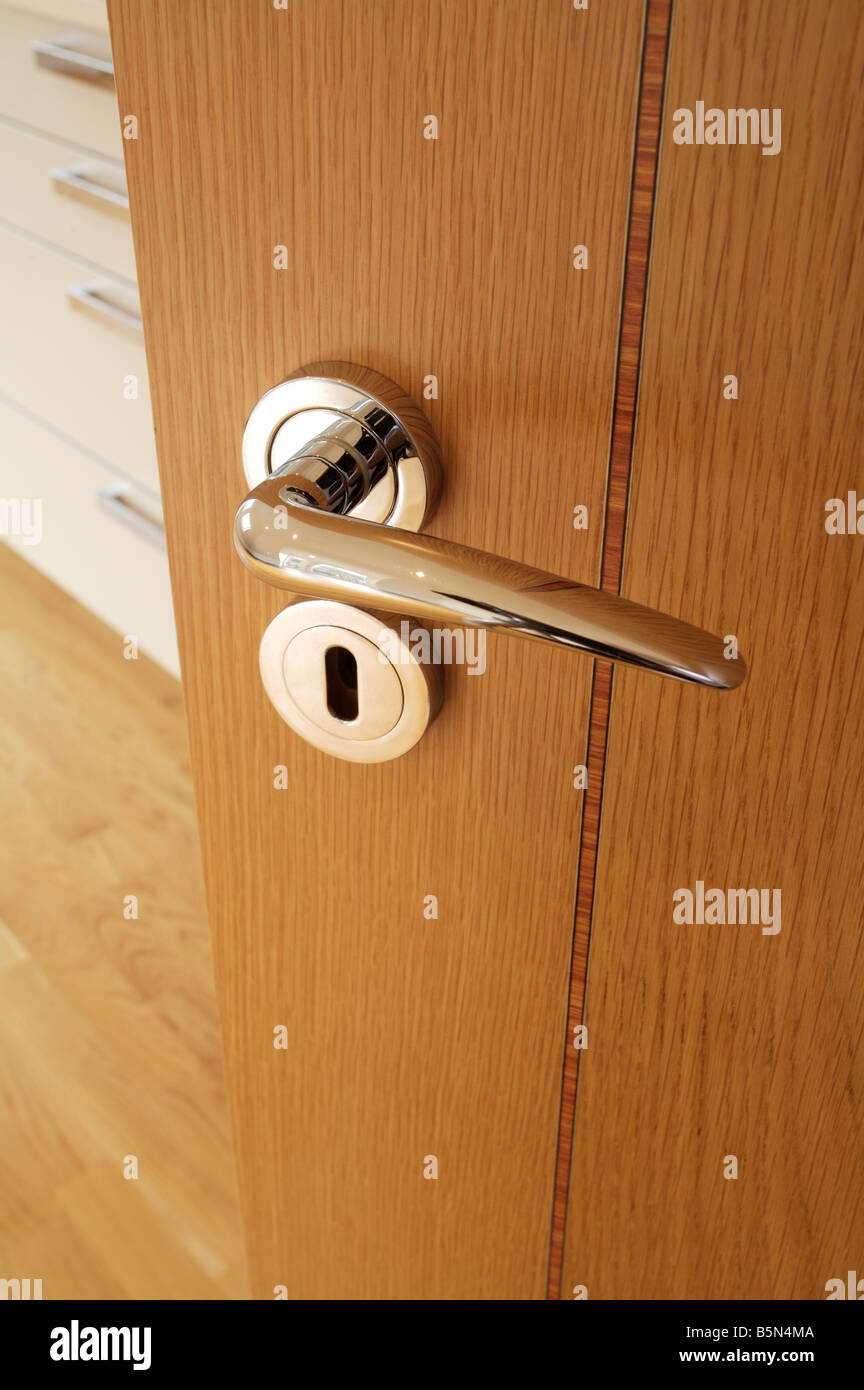Chrome plated door handle and escutcheon on an inlaid oak veneered door in a luxury apartment & Escutcheon Stock Photos \u0026 Escutcheon Stock Images - Alamy