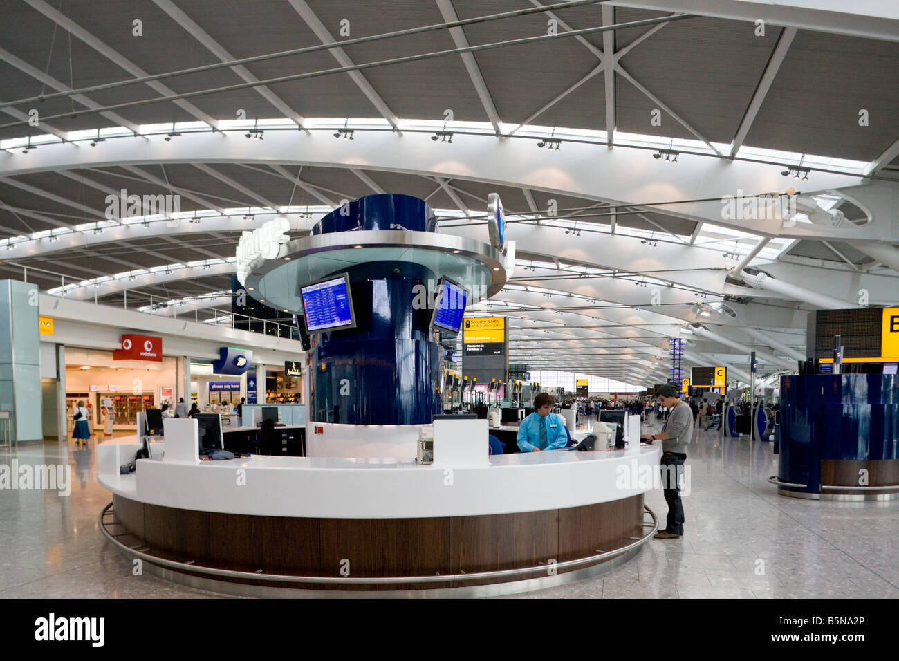 inormation desk, Terminal 5, Heathrow, London, England - Stock Image