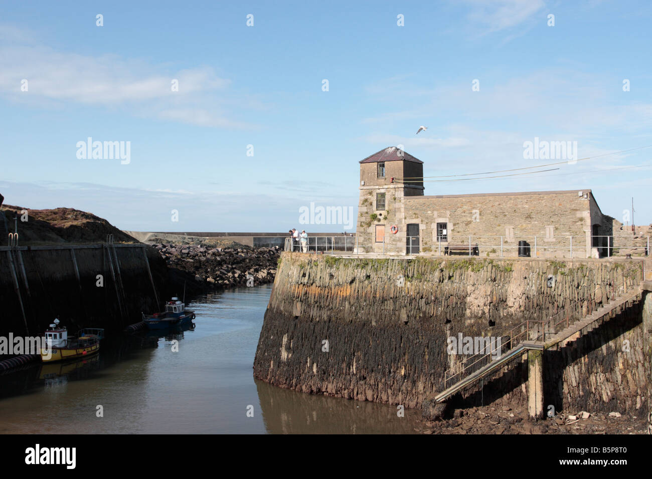 The port of Amlwch at low tide It was built to export copper from the Parys mountain mine in the 1700s, Anglesey, - Stock Image