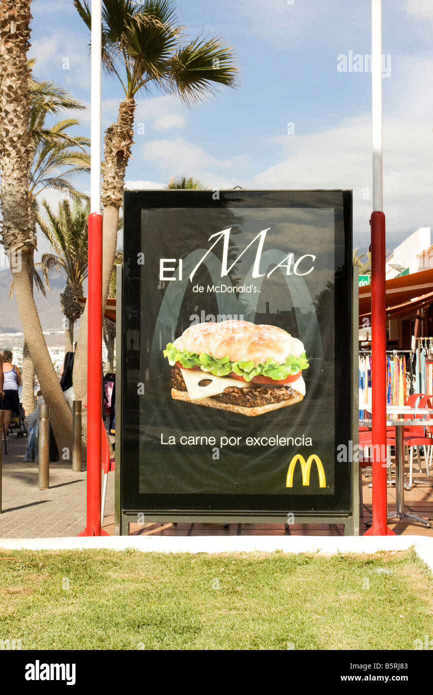 A Spanish advertising billboard for a McDonald s burger - Stock Image
