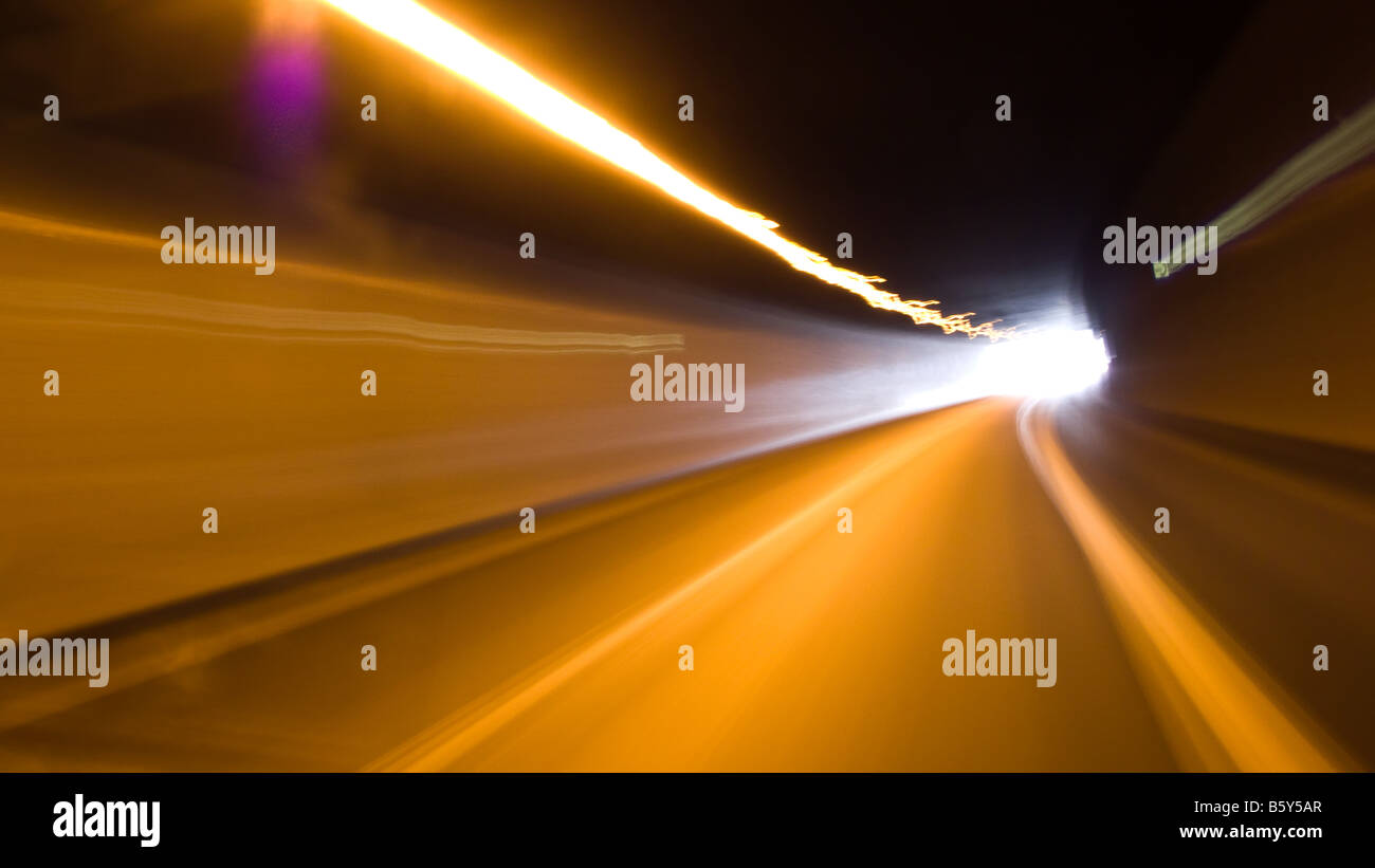 On the road -- Speedy and dynamic drive, seeing the light at the end of the tunnel. - Stock Image