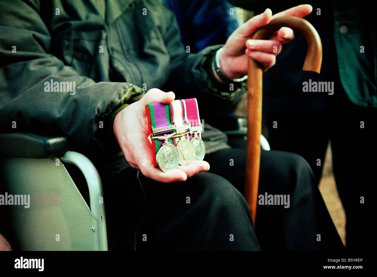 Wheelchair bound british gulf war veteran holds his medals outside the ministry of defence headquarters in london Stock Photo