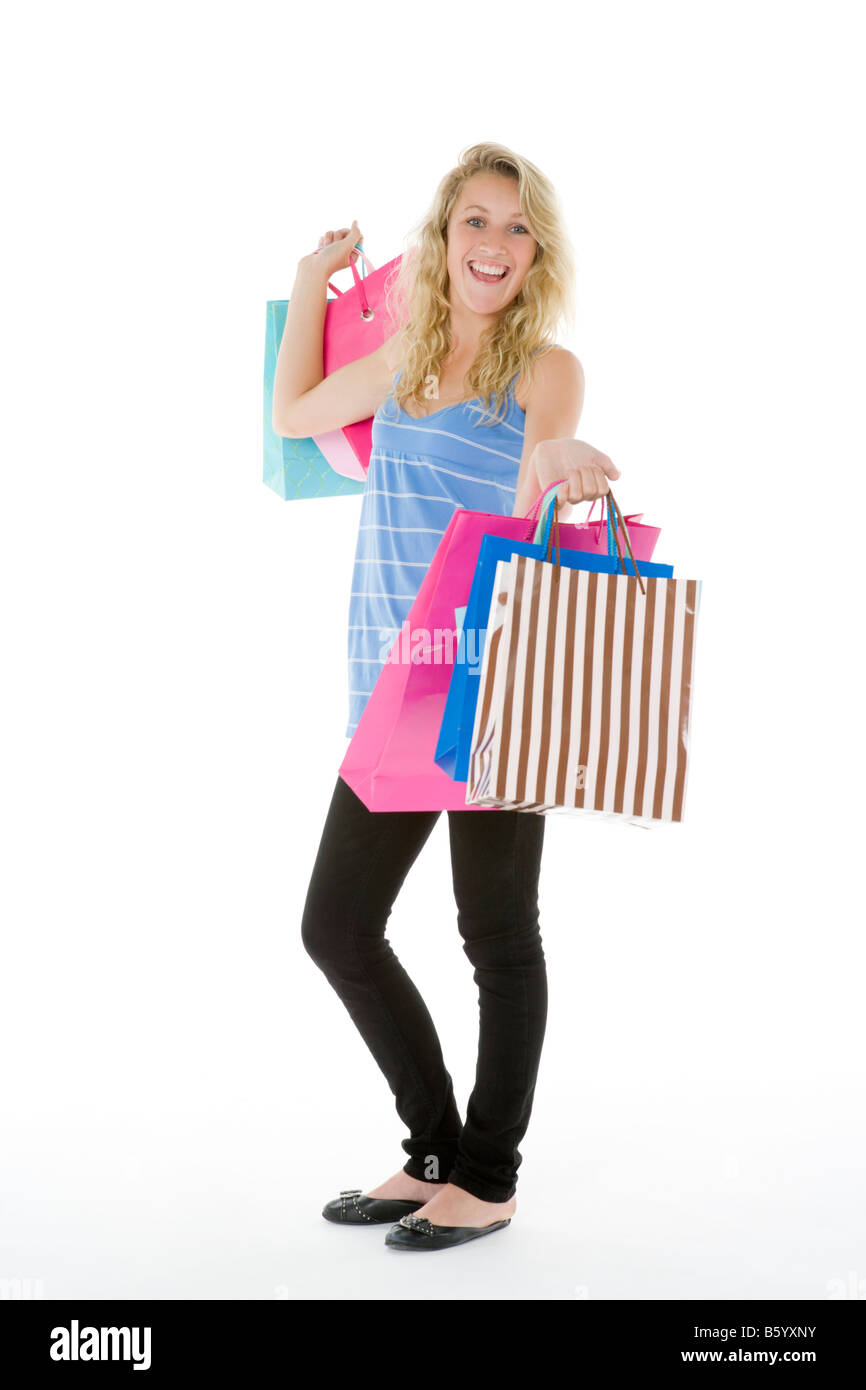 Teenage Girl Showing Off Her Shopping - Stock Image