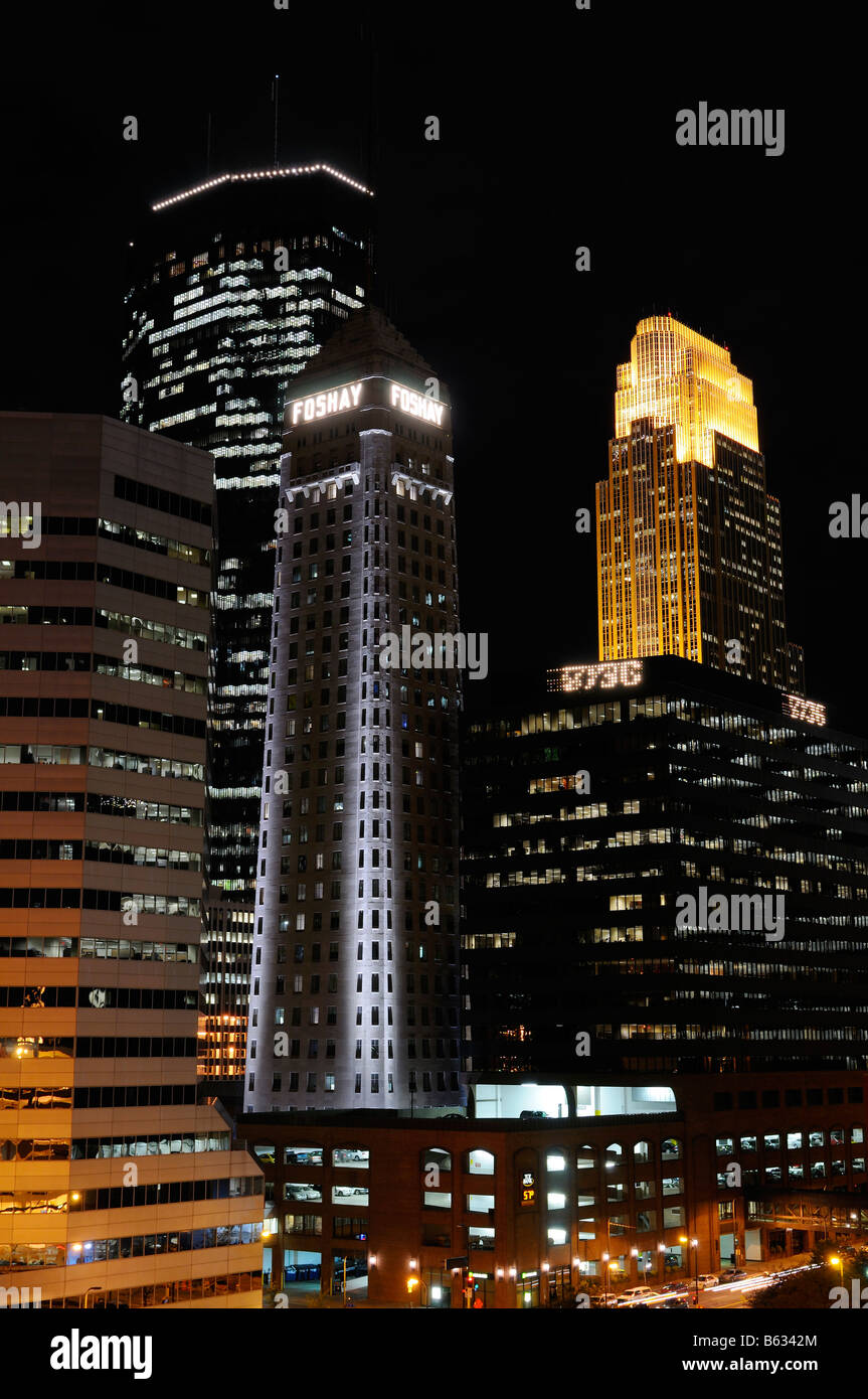 Downtown Minneapolis with lit financial center highrise office towers after dark - Stock Image