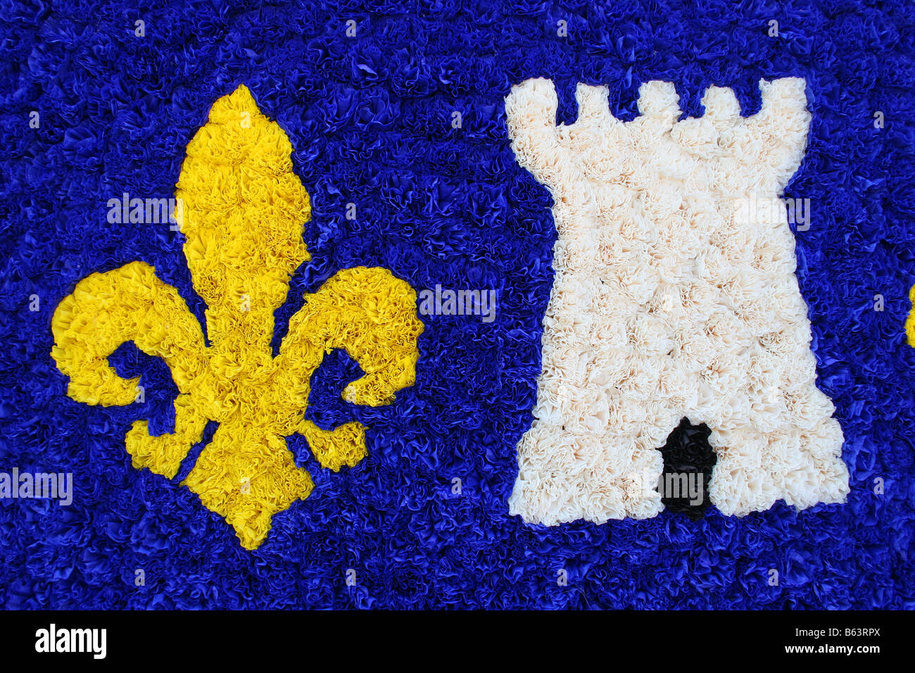 867b8d4318 Yellow and blue fleur de lys made of paper flowers. St Vincent Chablis.  Horizontal. 50664 Chablis2005