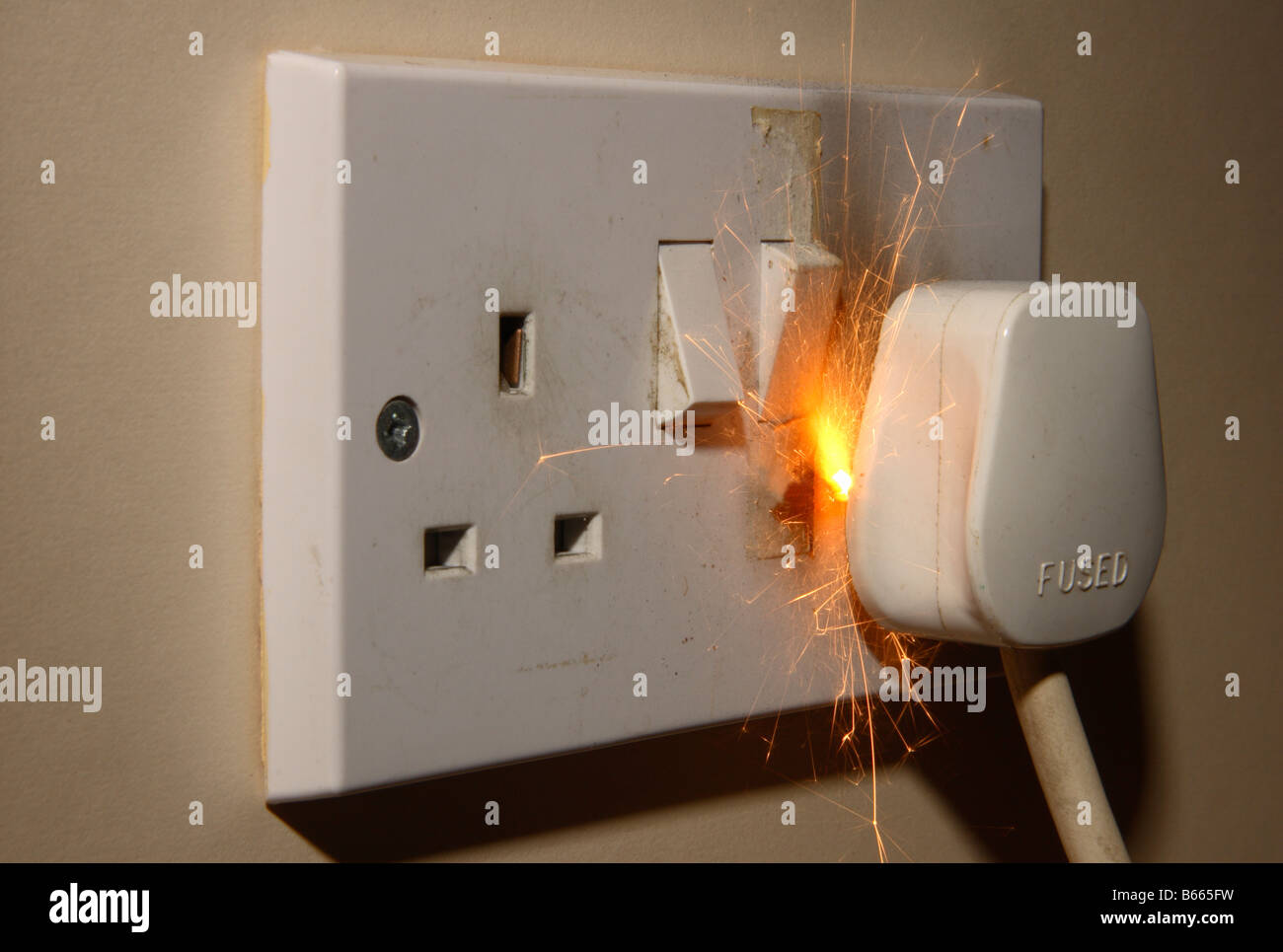 A fire in a 13a 240v electrical mains plug and socket stock photo a fire in a 13a 240v electrical mains plug and socket freerunsca Images