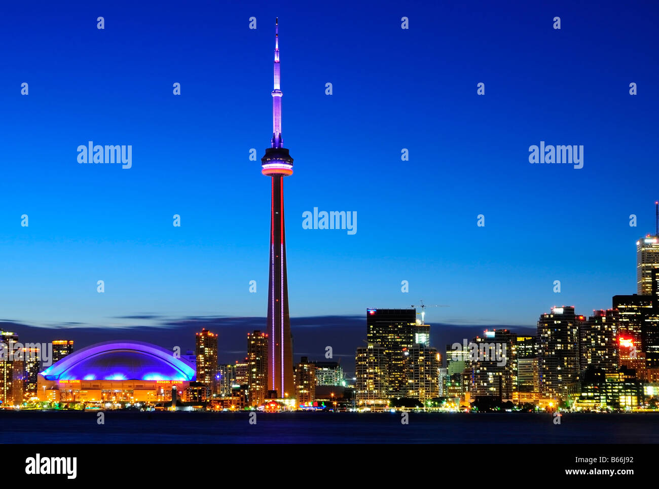 Canada, Toronto, Ontario, city skyline,  CN Tower, Rogers Center and financial district at night, view from the - Stock Image