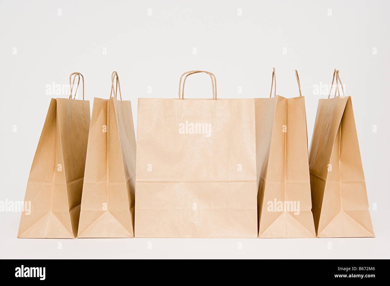 Paper bags in a row - Stock Image