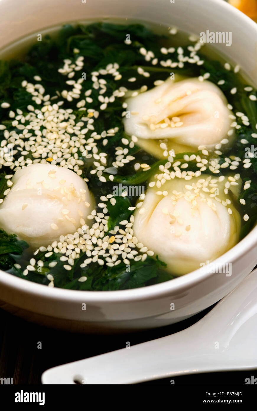 Close-up of Chinese dumplings in a bowl - Stock Image