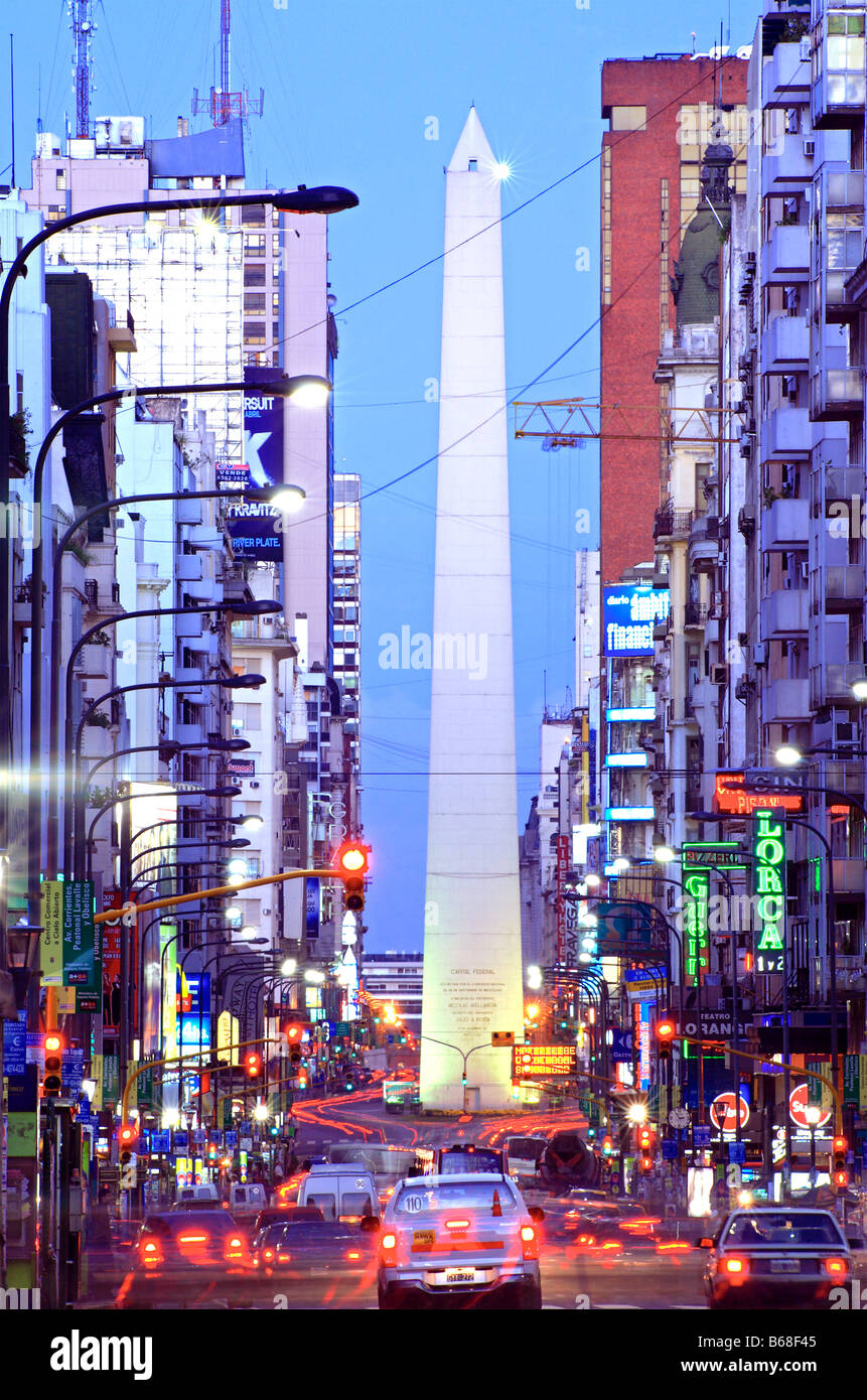 Far view of Corrientes Avenue, with Obelisco Monument and cars, at night, with vehicle lights as lines. Buenos Aires, - Stock Image