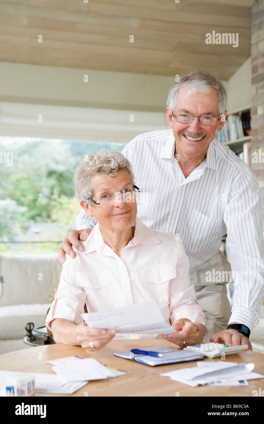 Couple preparing home finance budget - Stock Image