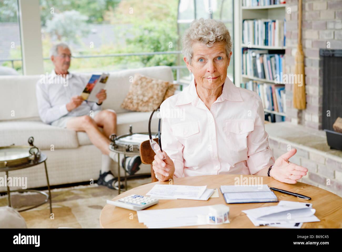 Woman preparing home finance budget - Stock Image