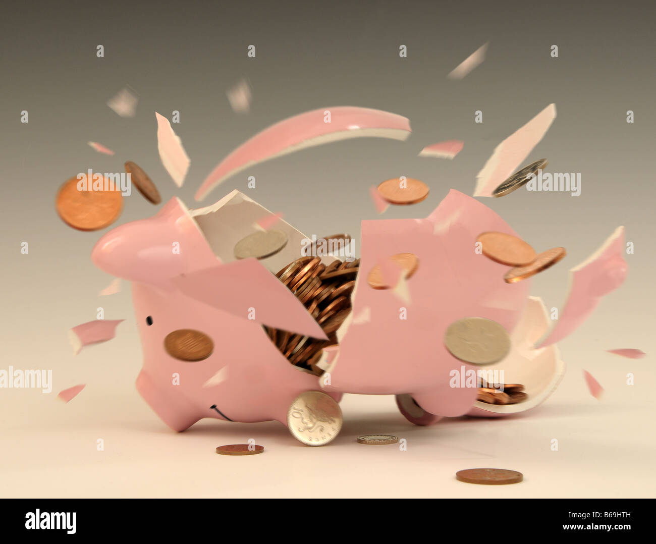 Piggy Bank being smashed open, image by Tony Rusecki Stock Photo