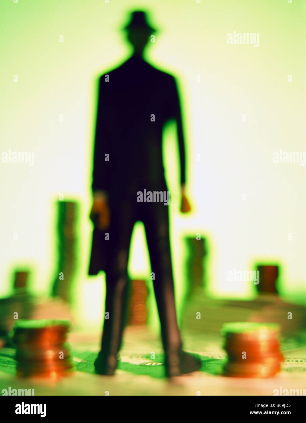 miniature businessman navigating money landscape with coins concept conceptual financial planning goals. ©mak - Stock Image