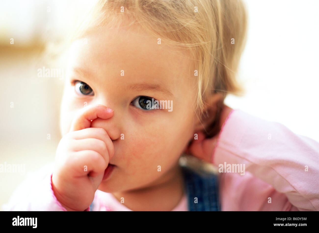 Young girl sucking thumb. - Stock Image