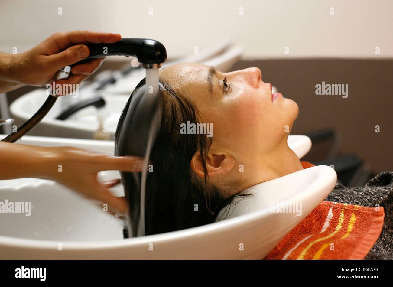 Young Woman Having Her Hair Washed Before Haircut Stock Photo