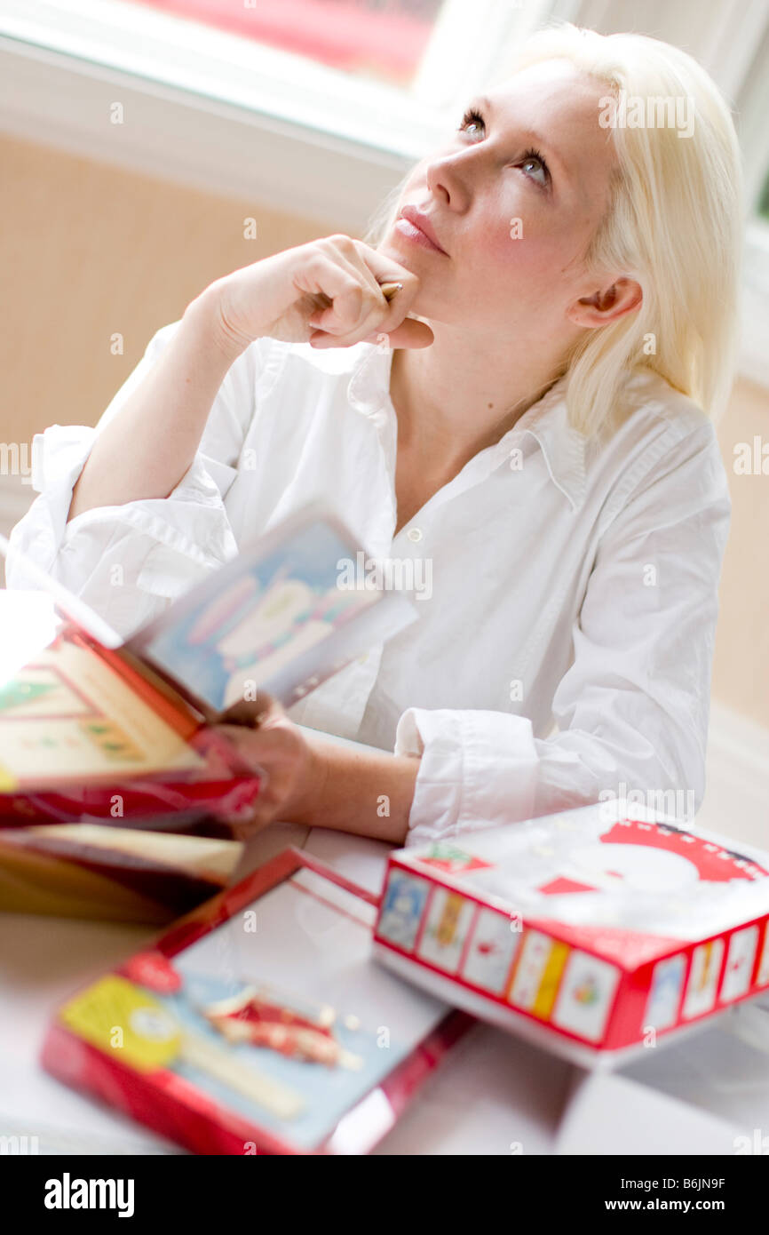 Woman writing out Christmas cards - Stock Image