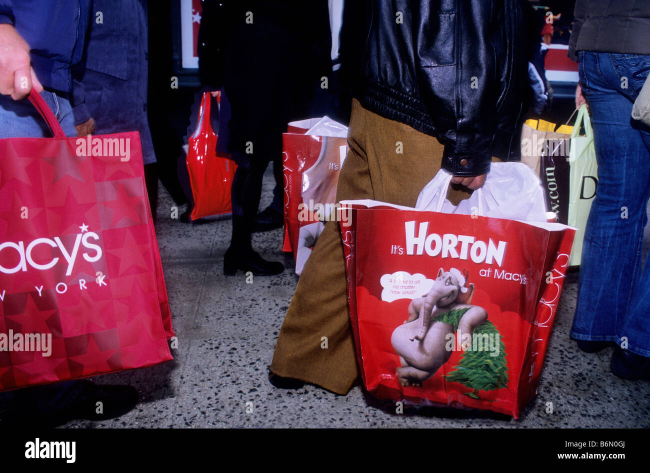 2c707564221f Christmas Shopping New York City People Carrying Shopping Bags in Front of  Macy s Department Store USA