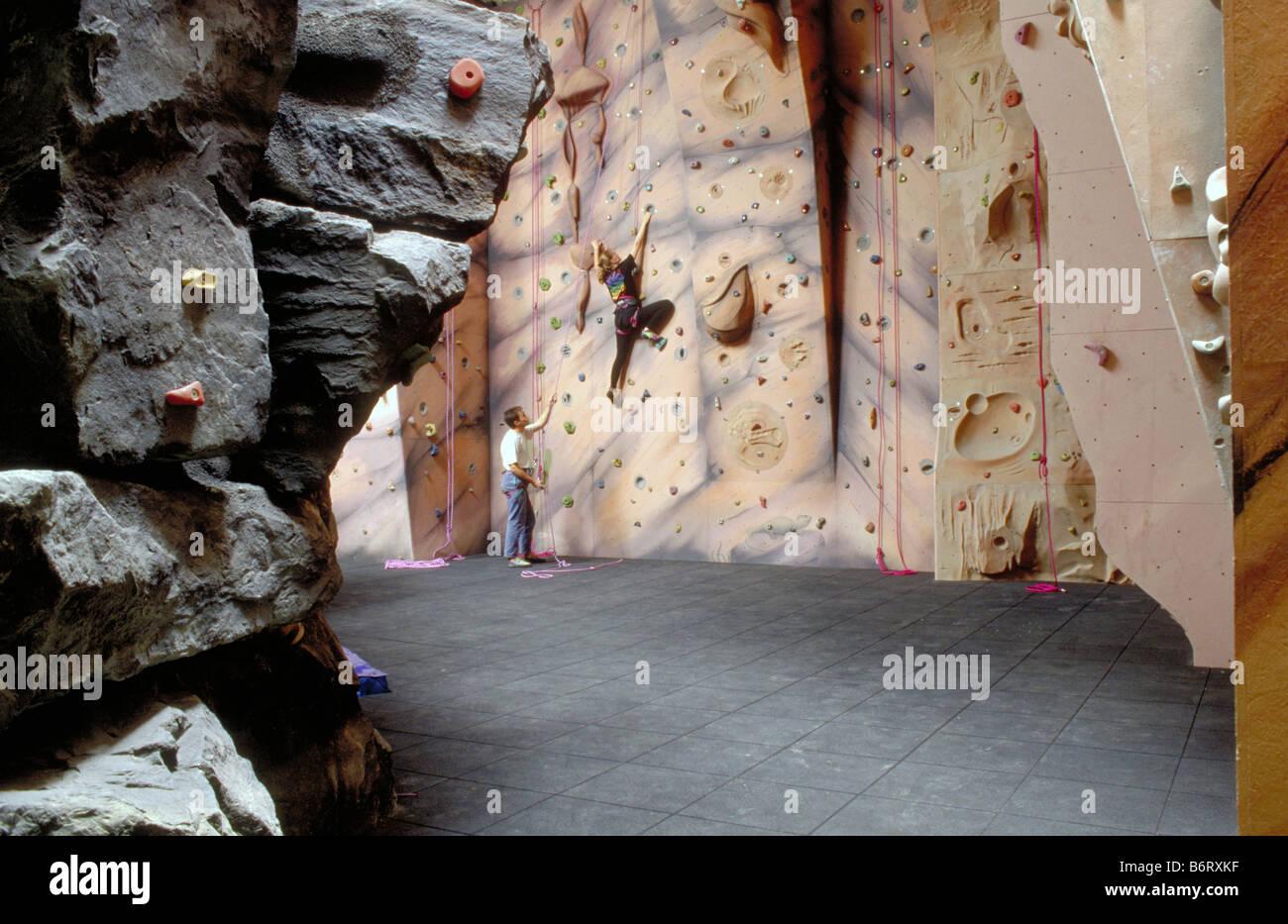 Climbers Climbing on Artificial Indoor Climbing Wall - Stock Image