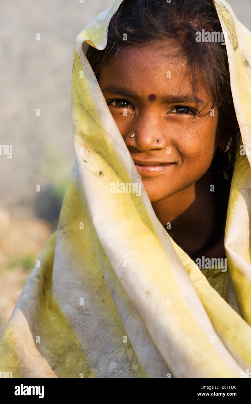 Poor Nomadic Indian Girl Wrapped In A Dirty Sheet Smiling Portrait Andhra Pradesh India